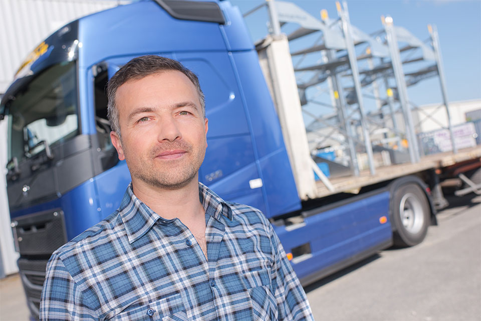 Man standing by truck