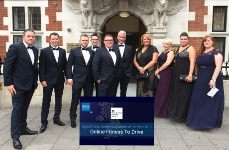 the team standing together outside a building at the awards