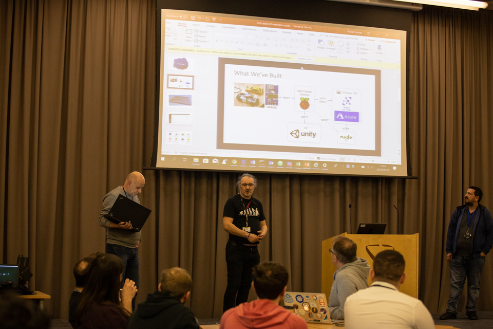 Photo of people presenting at DVLA Hackathon
