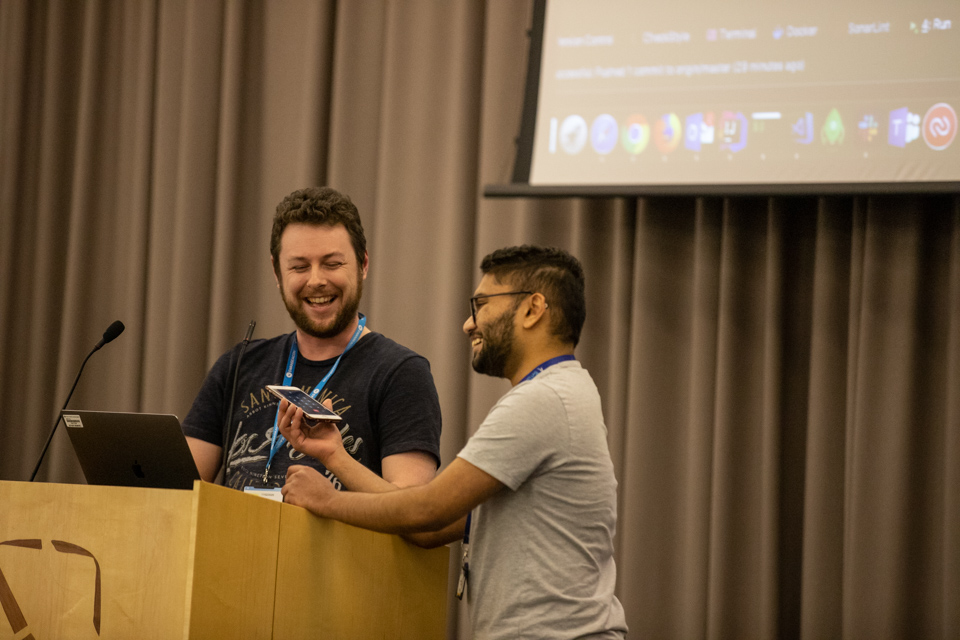 Photo of two people presenting at DVLA hackathon